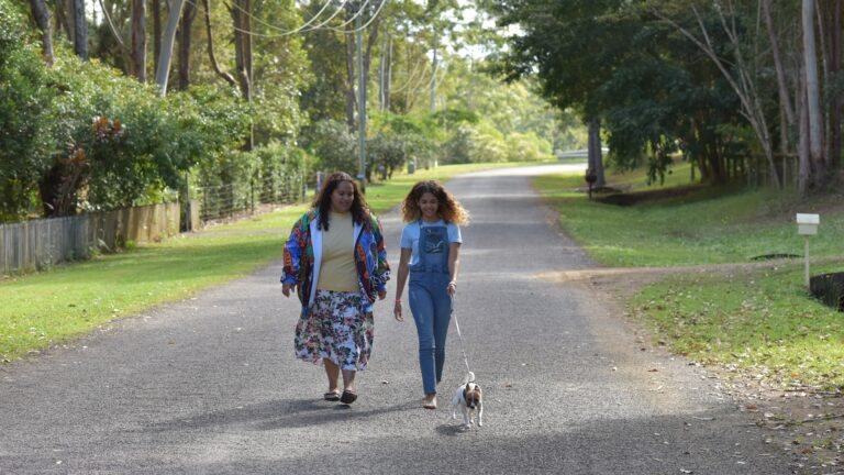 Mother and Daughter walking dog