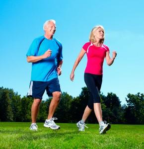 Mature man and woman briskly walking