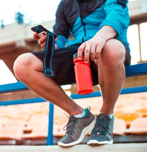 Man resting after run with drink bottle