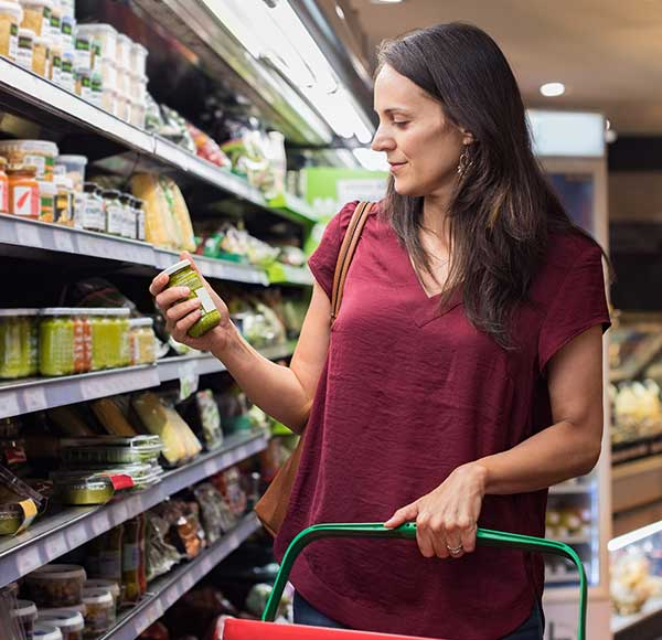 Woman looking at the label while shopping