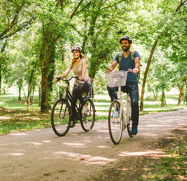 Couple cycling in a park