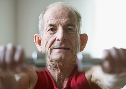 Elderly man doing workout