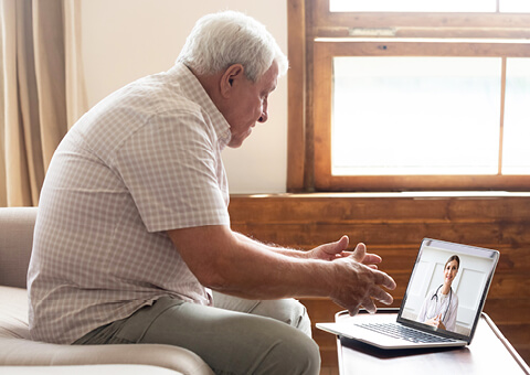 Man using laptop to video chat