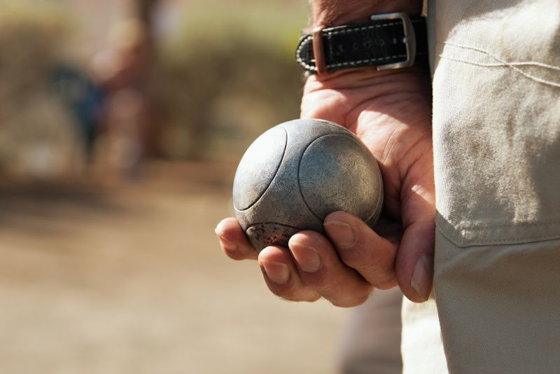 Close up of bocce ball in hand