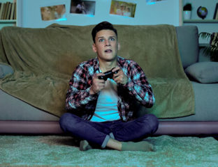 Man playing video games late at night