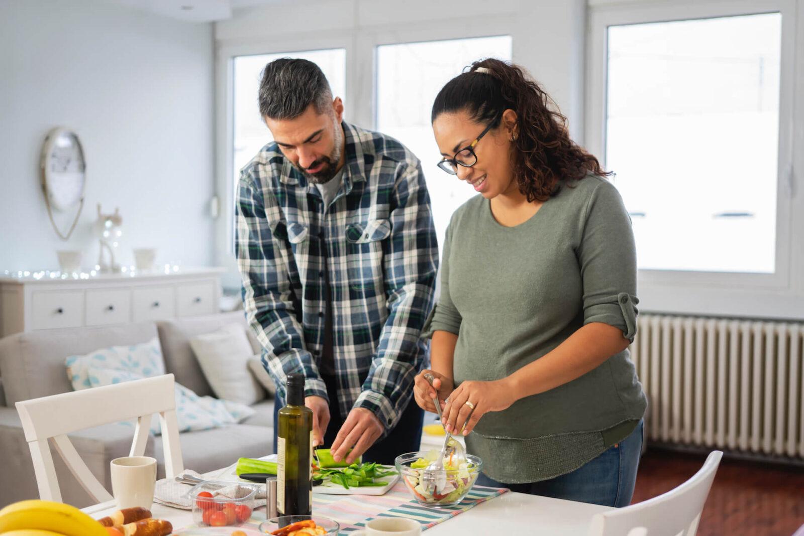 Couple preparing a salad