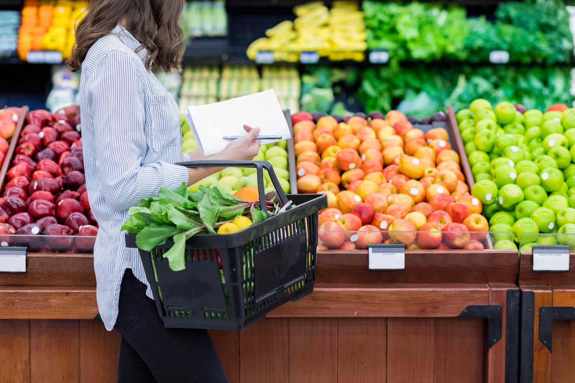 Woman selecting vegetables at the grocery store
