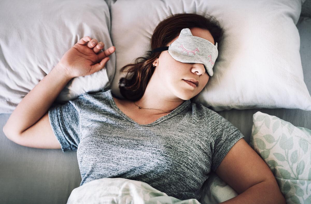 Woman sleeping with eye mask on