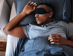 Man sleeping with eye mask on