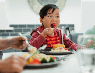 Child eating a mouthful of food