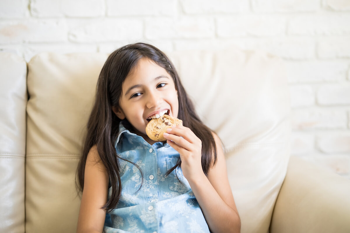 Girl eating a biscuit