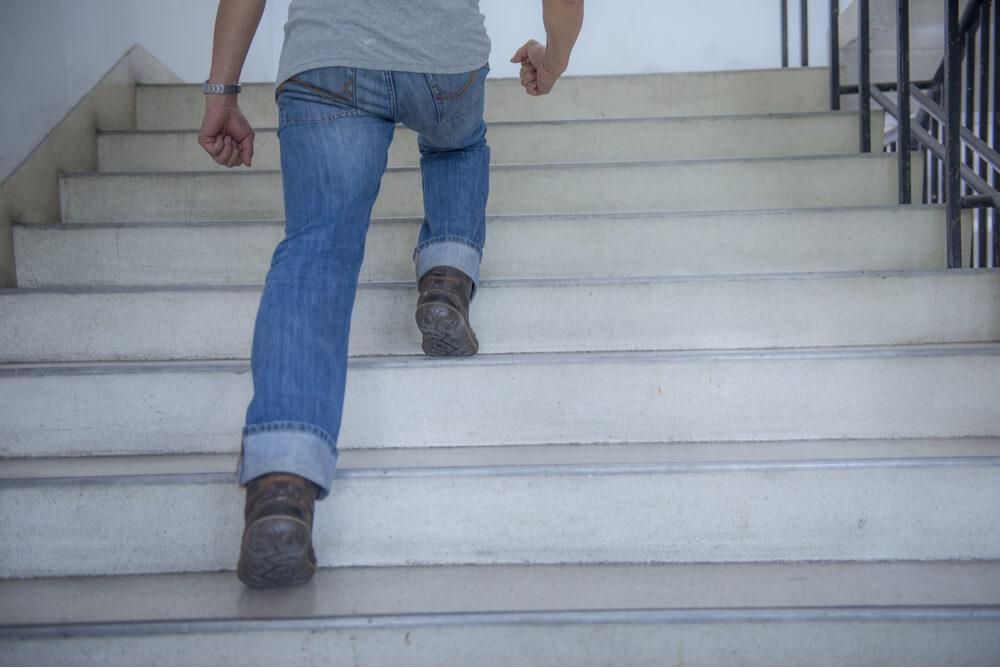 Man walking up stairs