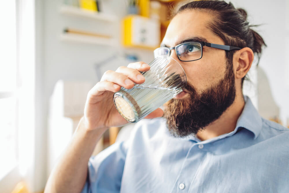 Man drinking water from a glass
