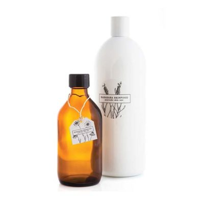 Amber bottle and white plastic bottle refills
