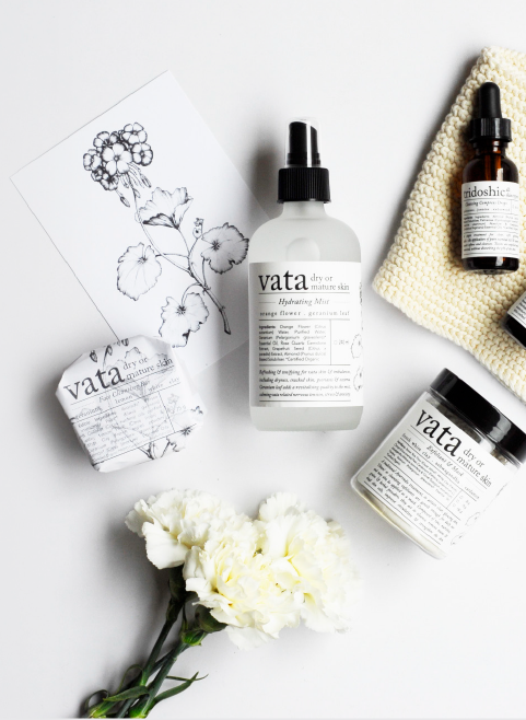 vata and tridoshic skin care bottles with flowers