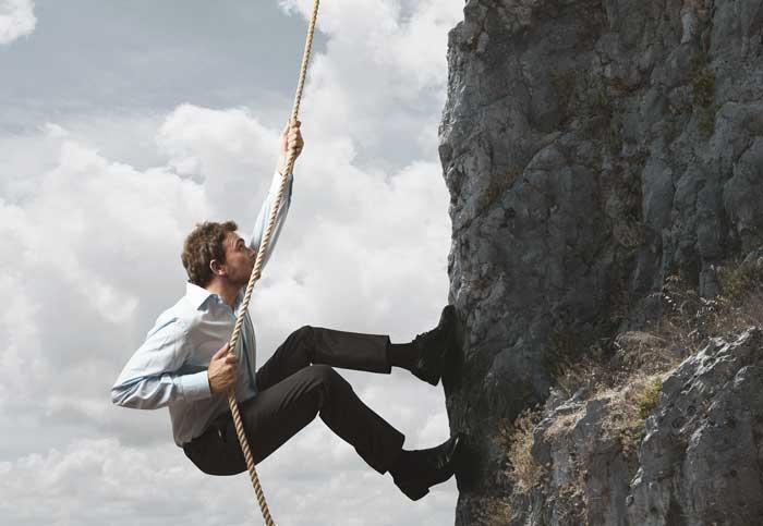business-entrepreneur-climbing-mountain-concept-for-startups