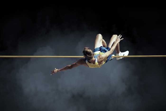 high jump athlete making successful jump