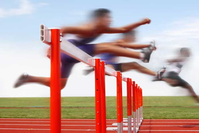 athletes jumping hurdles as concept of startups avoiding hurdles