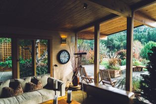 Preparing your property for sale - a beautiful wooden interior home looking out towards a green garden
