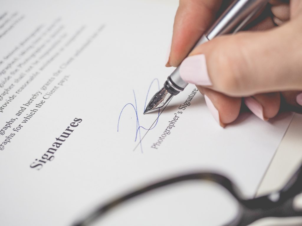 A signature being made after choosing the right home loan