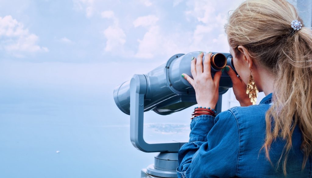 a girl looking through binoculars for a rental property