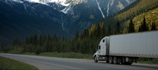 A removalist truck after packing, driving through mountains