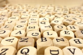 Mortgage jargon can seem like a scramble of letters as in this picture of scrabble-like dice