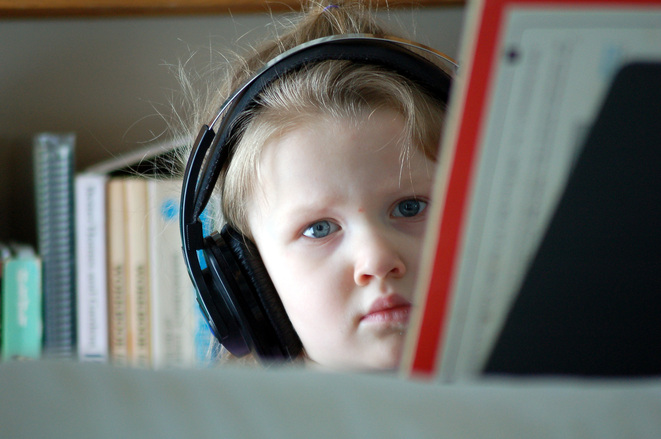a reality of small houses - you will need to wear headphones like this girl!
