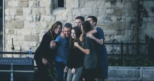 A group of young renters gather for a selfie