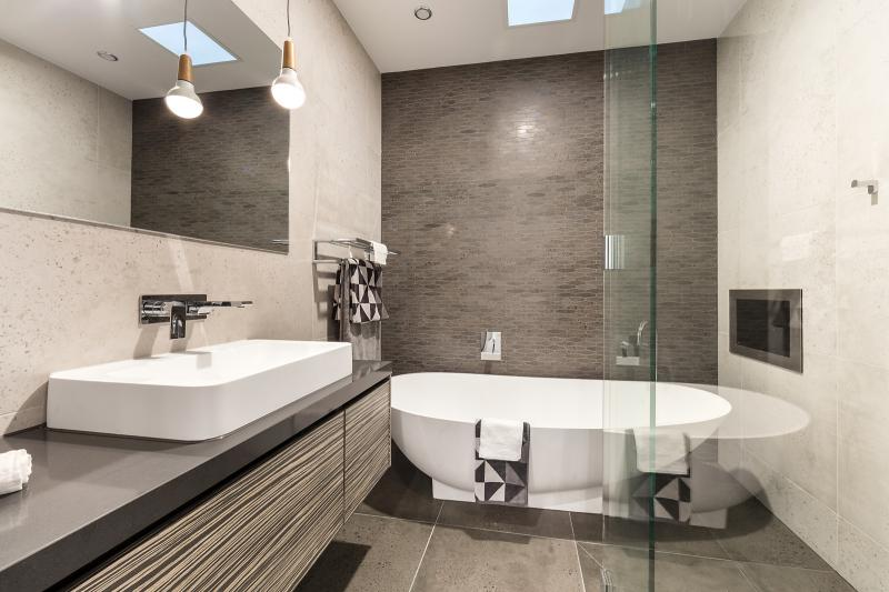 A bathroom with freestanding bath.