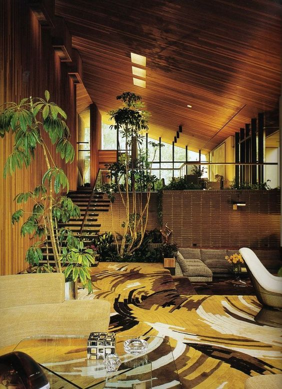 A 1970's home using wood, mustard accents and plants.