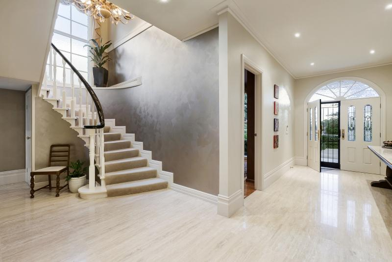 An entryway with elegant staircase.