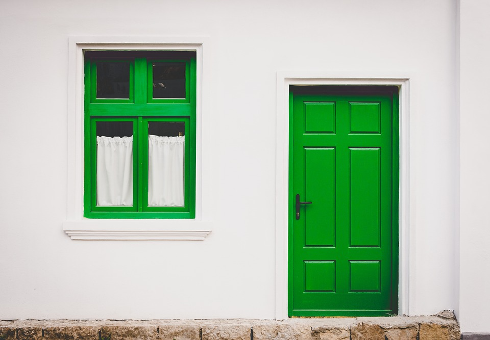 A home with a green door and window