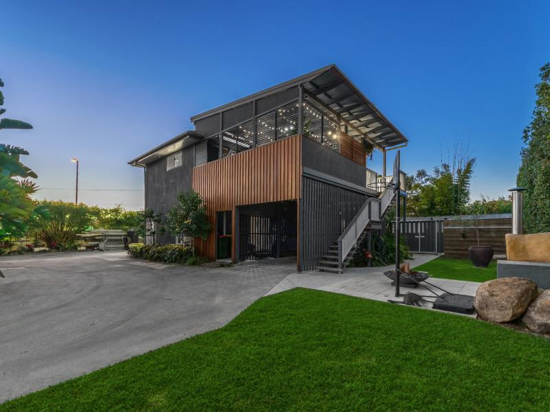 Facade shot of a timber and concrete look home in Queensland