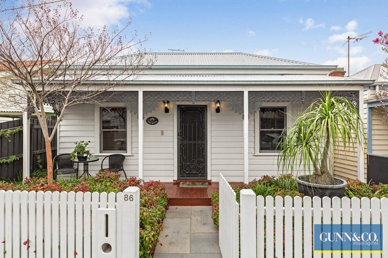 A home with a white picket fence