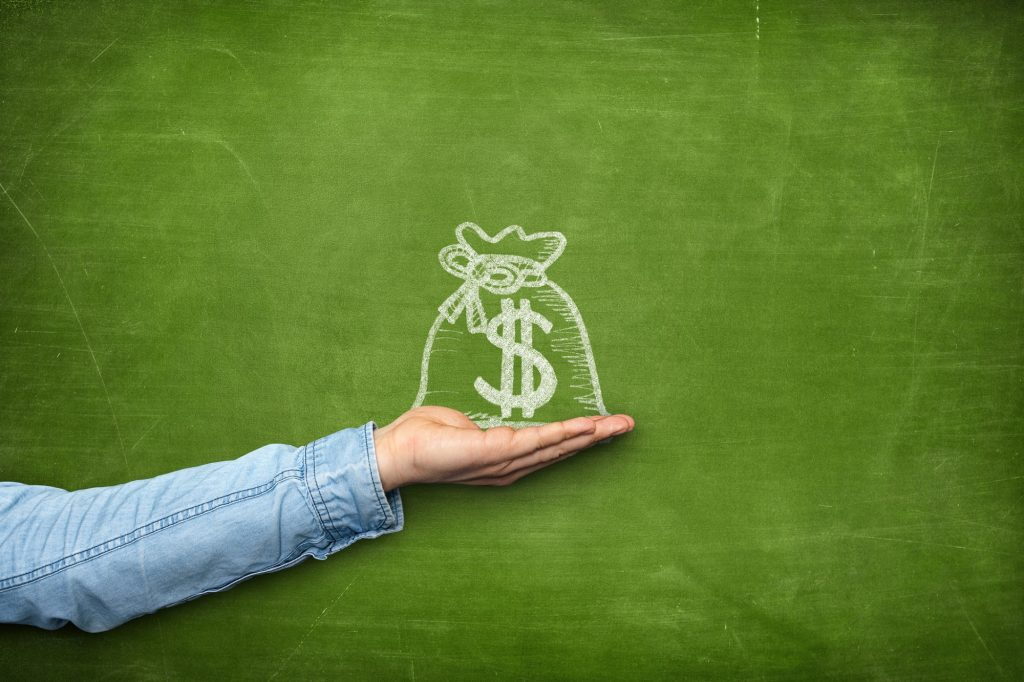 Money bag icon on blackboard with hand - saving with the 50-30-20 rule