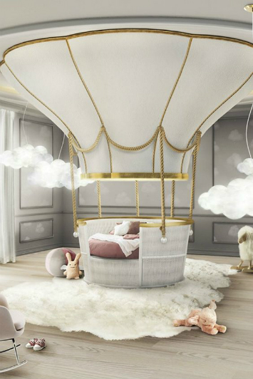 A kids room where the bed is a hot air balloon