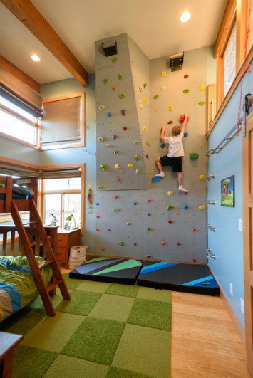 A kids room with a rock climbing wall