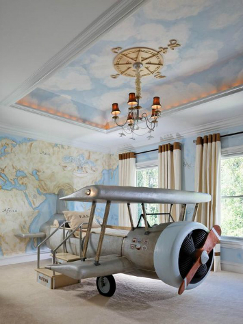 A kids bedroom with an airplane as the bed
