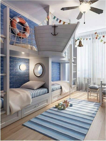 A nautical inspired bedroom with a ships hull above the bed.