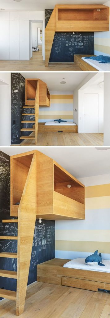 A kids bedroom where the bed looks like a modern cubby house