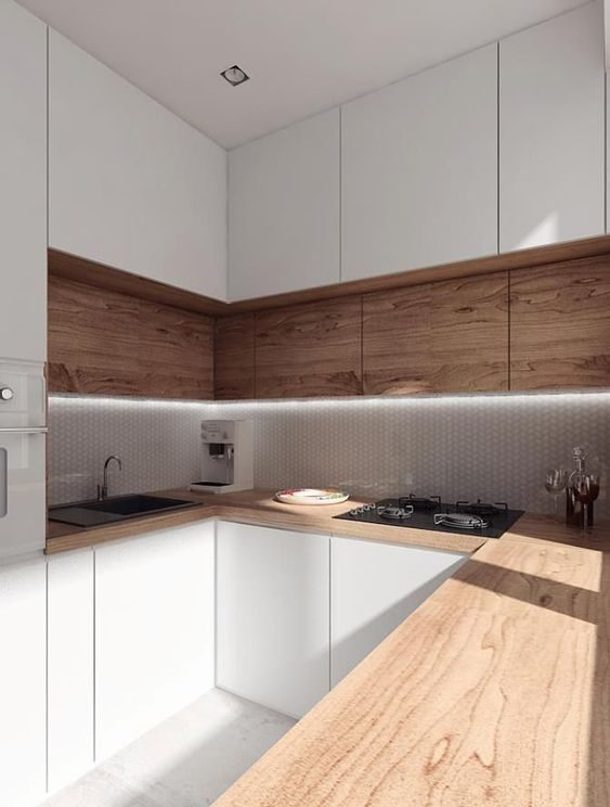 A kitchen with a mix of timber shelves and white panel shelving, with a timber bench top.