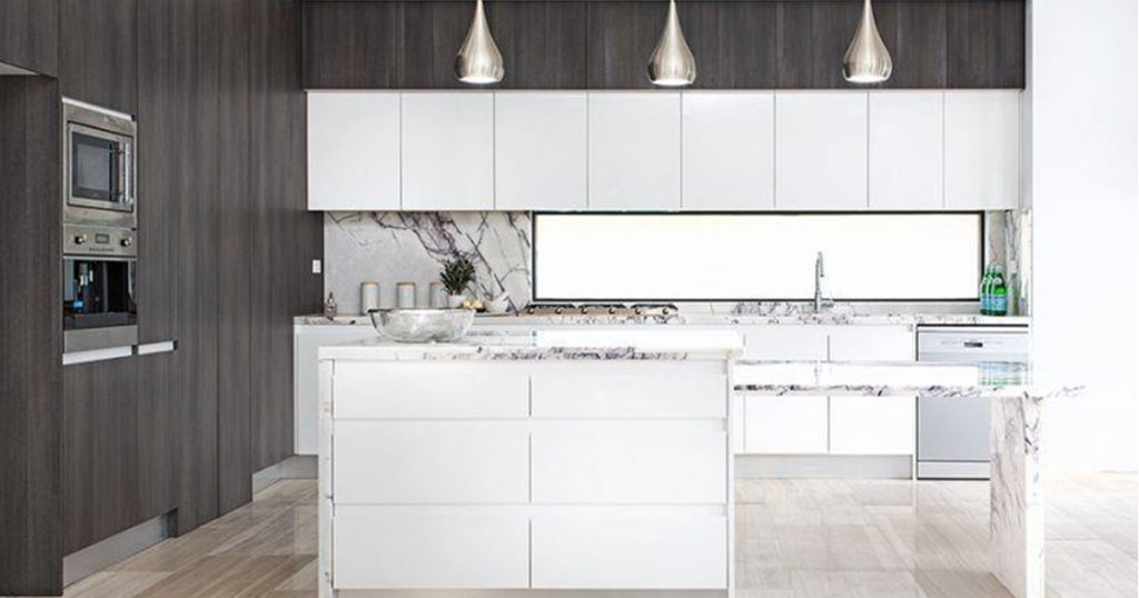 A white kitchen with a kitchen island in the foreground.