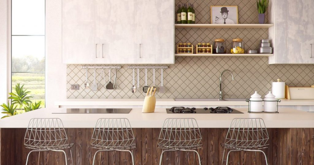 A kitchen with four bar chairs placed in front of a timber and white marble kitchen island that reflects a healthy kitchen workflow.