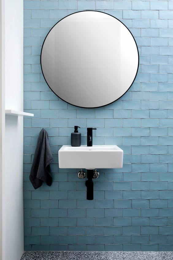 Light blue tiling on a bathroom sink wall