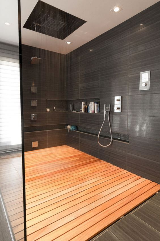 A shower with timber slat flooring
