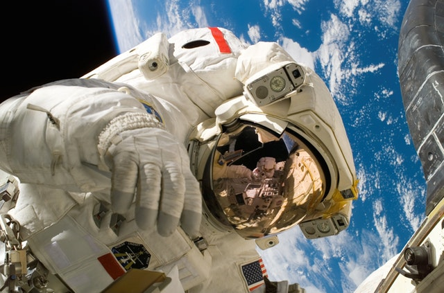 A person in a spacesuit walks in space