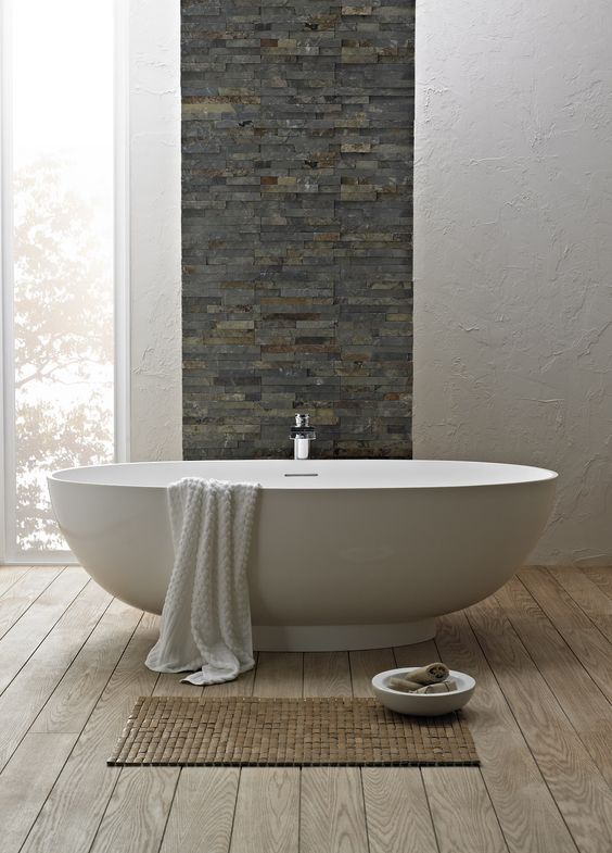 A bath in front of a stone wall