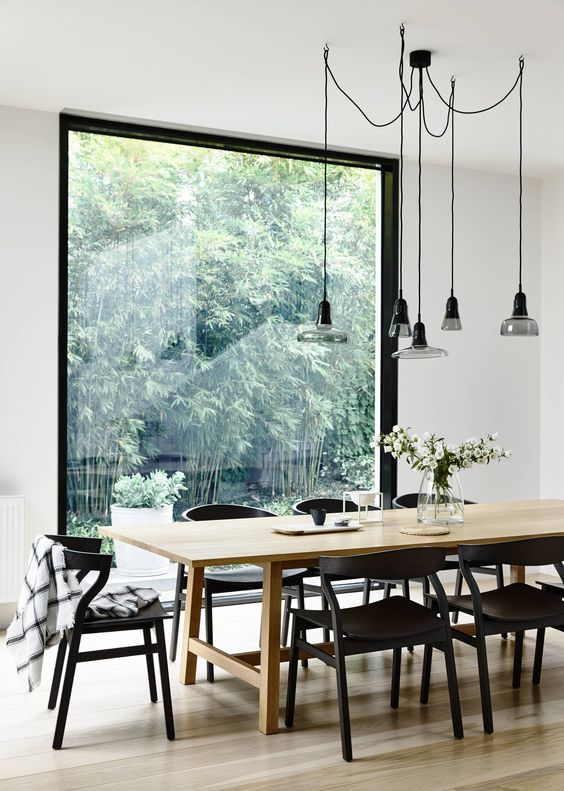 A modern table and chairs in a dining room