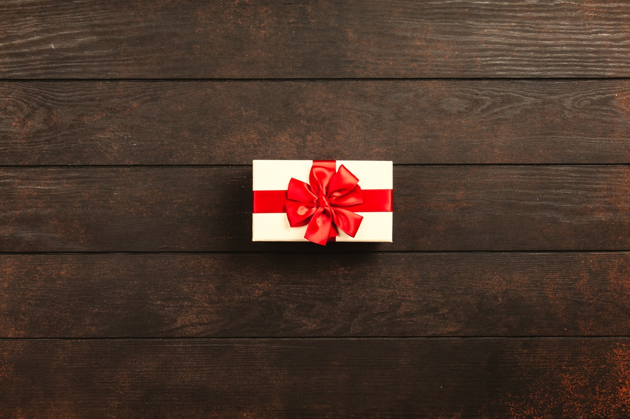 A gift with a red ribbon